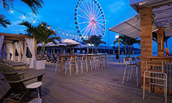 An outdoor patio at the Hard Rock Hotel, close to a ferris wheel